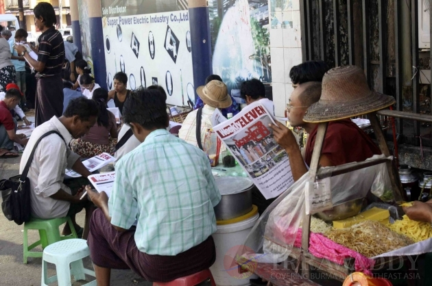 Publics follow up the news in Rangoon, Burma.