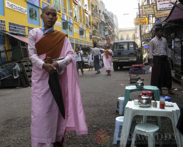 Nuns are asking for alms at the shop in Rangoon, Burma.