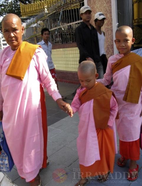 Nuns are walking on the street in Rangoon, Burma.