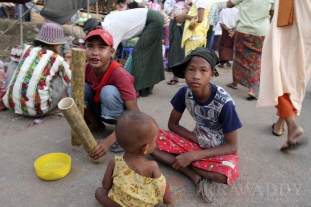Children begging on the street in Burma