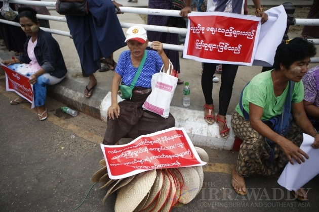 against hawkers on downtown pavements