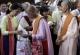 NLD leader Aung San Suu Kyi donates to nuns in Rangoon, Burma.