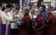 Novices receive donation of alms from NLD leader Aung San Suu Kyi in Rangoon, Burma.