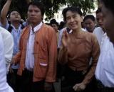 Pro-democracy leader Aung San Sun Kyi was greeting journalist during walk to headquarter in Rangoon, Burma.