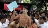 Aung San Suu Kyi among the media on the National Day in front of the NLD headquarters in Rangoon, Burma.