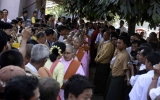 NLD leader Aung San Suu Kyi donates to nuns in Rangoon, Burma.