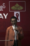 Aung San Suu Kyi's younger son Kim Aris entertained for people with HIV/AIDS on World AIDS day.