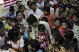 Burma pro-democracy leader Aung San Suu Kyi was among children on the World AIDS day.