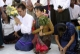 Burma pro-democracy leader Aung San Suu Kyi and her youngest son Kim Aris pay homage to Buddha at Shwedagon Pagoda in Rangoon, Burma.