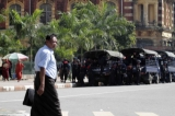 The trucks of riot polices parking at the City Hall tighten security near the polling station, in Rangoon, Burma.