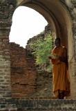A monk is reading at the Bagan pagoda.