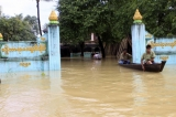 Two boats of flood victims float around the monastery in Bago division in Burma.