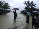 Flood victims attempt to get away from the flood in Arakan State, Western Burma.