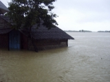 Half of the house is under the water in Arakan State, Western Burma.