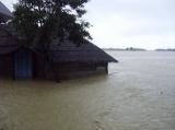 Half of the house is under the water in Arakan State, Western Burma.