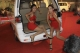 22-01-11 Burmese models pose with locally made autos during Myanmar Auto and Auto Parts Expo in Rangoon, Burma.
