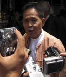 U Kyi Maung talks to media outside Burma Supreme court.