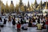 Buddhist devotees pray at Victory Ground of Shwedagon Pagoda in Rangoon, Burma.