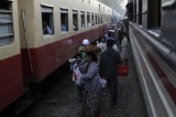 12-01-11 Vendors sell snacks to passengers at a railway station in Myitkyina, Kachin State, northern Burma