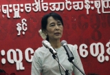 Burma pro-democracy leader Aung San Suu Kyi addresses during meeting with youth members of her National League for Democracy at the party's headquarters in Rangoon, Burma.