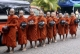 Novices walk through the road while asking for alms in Rangoon, Burma.