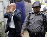 Ross Dunkley, editor of the Myanmar time's journal, is seen outside the Kamayut township court before hearing at the court Tuesday, in Rangoon, Burma. The court will hear his appeal at 17 March, 2011.