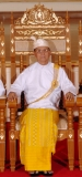 Burma President Thein Sein sits on chair as he poses for photo at the parliament in Naypyidaw, Burma.