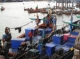 Burmese workers are working at the port in Ranong,  Southern Thailand.