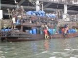 Burmese workers are working at the port in Ranong, Thailand.