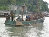 A fishing ship leave the port in Ranong, southern Thailand.