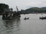 A fishing ship leave the port in Ranong, Thailand.