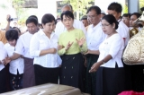 Burma Pro-democracy leader Aung San Suu Kyi attends a ceremony of the 10th founding anniversary of a private charity group, the Free Funeral Service Society in Rangoon, Burma.