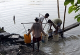 Villagers fetch drinking water from a lake in Dalla Township in Rangoon, Burma.