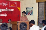 Burma pro-democracy leader Aung San Suu Kyi delivers her speech to farmers during two day workshop on education Myanmar farmer at NLD party's headquarters in Rangoon, Burma.