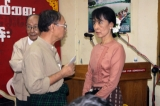 Burma pro-democracy leader Aung San Suu Kyi talks to farmers during two day workshop on education Myanmar farmer at NLD party's headquarters in Rangoon, Burma.