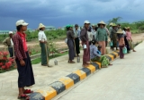 Daily waged workers gather on a road in Nayphitaw, the capital in Burma.