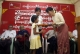 Burma pro-democracy leader Aung San Suu Kyi donates cash to family members of political prisoners during a ceremony of donation cash to family members of political prisoners at NLD party's headquarters, in Rangoon, Burma.