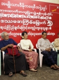 Burma pro-democracy leader Aung San Suu Kyi and party's senior leaders attend a ceremony of donation cash to family members of political prisoners at NLD party's headquarters in Rangoon, Burma.