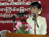 10-05-11 - Photo:- Irrawaddy Family members of political prisoners and Burma pro-democracy leader Aung San Suu Kyi attend a ceremony to donate cash at NLD party's headquarters in Rangoon, Burma.