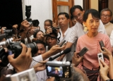 Burma pro-democracy leader Aung San Suu Kyi (right) is surrounded by the media after meeting with Vijay Nambiar a top aide to U.N. Secretary-General Ban Ki-moon, at her home in Rangoon, Burma.