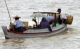 Passengers take a boat ride in Nyaung Tone, Burma Irrawaddy Delta, about 60 miles southwest of Rangoon, Burma.