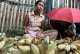 A vendor sells banana at market in Nyaung Tone, Burma Irrawaddy Delta, about 60 miles southwest of Rangoon, Burma.