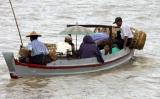 22-05-11 Photo Irrawaddy Passengers take a boat ride in Nyaung Tone, Burma Irrawaddy Delta, about 60 miles southwest of Rangoon, Burma.