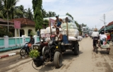 22-05-11 - Photo:- The Irrawaddy Villagers carry goods on their tractor as they return from market in Nyaung Tone, Burma Irrawaddy Delta, about 60 miles southwest of Rangoon, Burma.