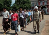 "Prisoners walk out the Burma's Insein Prison after they are released as the new government cut one year from their prison terms under a ""general amnesty"" programmed in Rangoon, Burma."