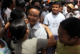 "Family members welcome prisoner outside the Burma's Insein Prison after they are released as the new government cut one year from their prison terms under a ""general amnesty"" programmed in Rangoon, Burma."