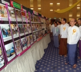 "Burma President Then Sein observes documentary photo as he attends the workshop on ""Rural Development and Poverty Alleviation"" in Naypyitaw, Burma."