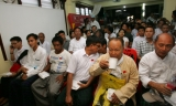 Political prisoners attend the welcoming ceremony and paper reading session on elections conducted by National League for Democracy party (NLD) at the headquarters in Rangoon, Burma.