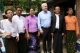U.S. Senator John McCanin (3rd from Right) poses photo with Phyu Phyu Thin (3rd from Left), the well-known AIDS activist, during his visit to the activist's shelter for AIDS patients in Rangoon, Burma.