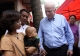 U.S. Senator John McCanin (Right) greets a child carrying HIV virus during his visit to Burma AIDS activist Phyu Phyu Thin's shelter for AIDS patients in Rangoon, Burma.